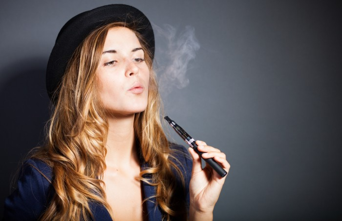 Girl Smoking Rechargable E-cigarette